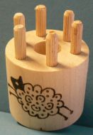 Bobbin with 6 wooden pegs