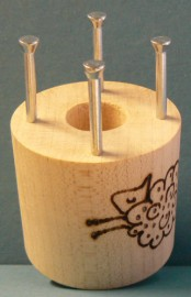 Bobbin with 4 metal pins
