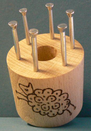 Bobbin with 6 metal pins